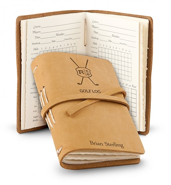 Personalized Leather Bound Golf Log Help your favorite golfer beat his personal best! Small enough to fit in a golf bag, yet big enough to clearly record and keep track of scores, this sophisticated gift is a must-have for golfers of all ages. Included in this Gift One Top Grain Genuine Leather Golf Log. 48 Pages with Blank Logs for 48 Rounds of Golf. Complimentary Embossing on Cover. Presentation Gift arrives presentation-ready in signature gift box. A free card with your personal message is included with your gift. GiftTree Personalization Free Embossing! One line with up to 15 characters. Enter information to be engraved using the personalization option during checkout. Gift Dimensions Measures 5.5'' x 3.5''